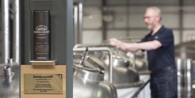 Ken Duncan, Head Brewer works behind the Vintage time capsule at The Innis & Gunn Inveralmond Brewery.