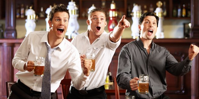 guys at bar screaming with beer