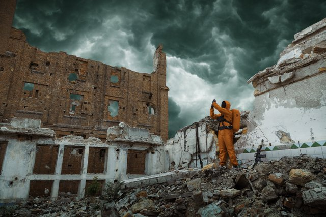 apocalypse guy in hazmat suit destruction